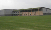 Project: Burnley FC Training Ground. Material: 21 x 140 Thermowood D Mineral Grey Coated. 42 x 42 Grey Batten.