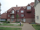 Project: Warwick Gates Care Village. Profile:  ex 200mm Rebated Bevel. Colour: New Pilgrim Red CCS70040